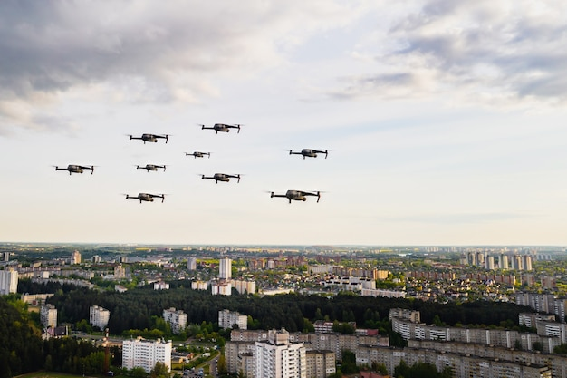 Drones fly over the city's houses. urban landscape with drones flying over it, quadrocopters flying over the city.