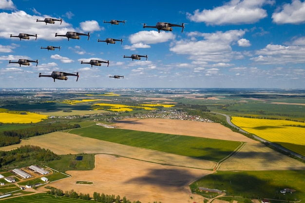Drones fly over the fields. natural landscape with drones and quadrocopters flying over it