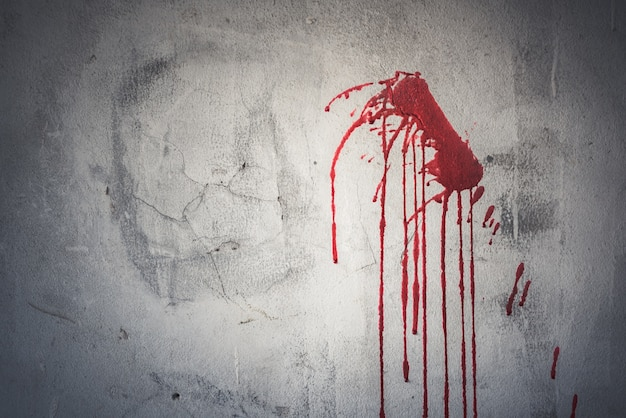 Drop of red blood on wall in abandoned house
