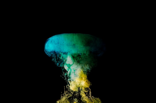 Drop of turquoise an yellow dye