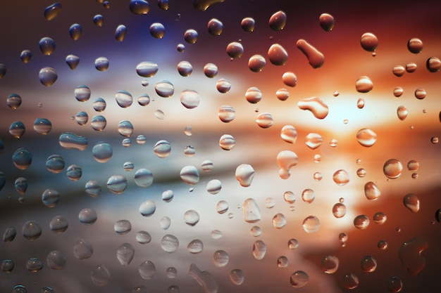 Drops on glass, colored abstract blurred light