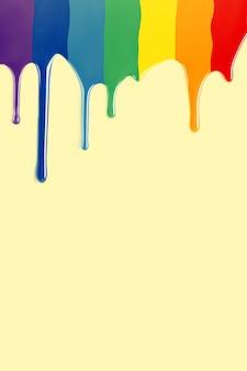 노란색 배경에서 lgbt 플래그로 떨어지는 페인트 방울. 페인트 무지개. 복사 공간이있는 수직 이미지.