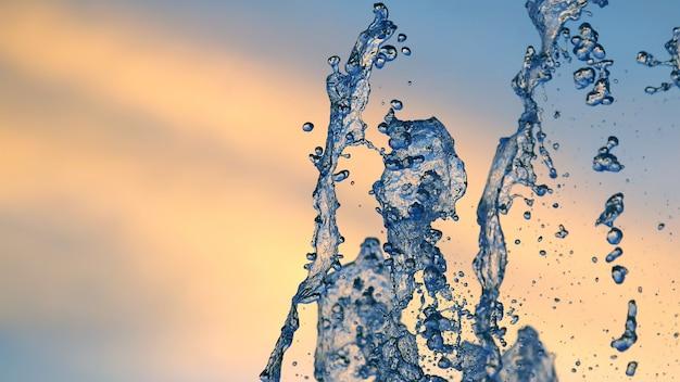 夕日の噴水のしずく。水と光の遊びにおける抽象化とぼやけ