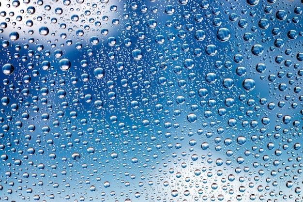 水滴。ガラスパターンテクスチャ背景にぬれた雨。