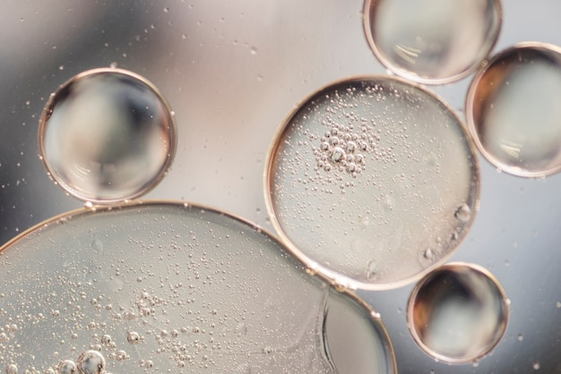 Drops of transparent water on glass surface