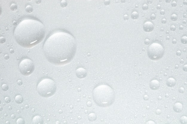 Drops of water on white surface