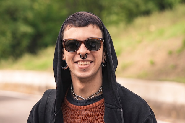 Drug addict boy with a particular smile in nature