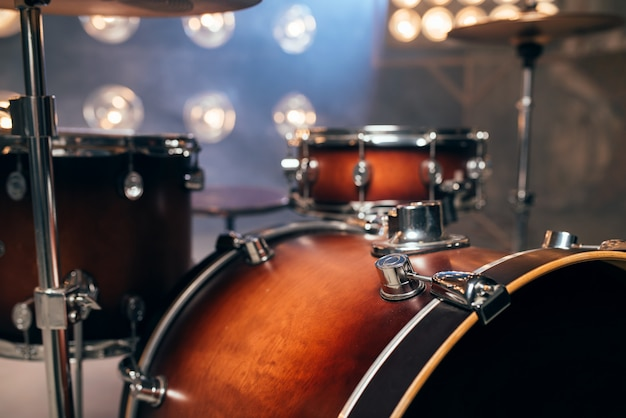 Drum-kit, drum-set, percussion instrument on the stage with lights