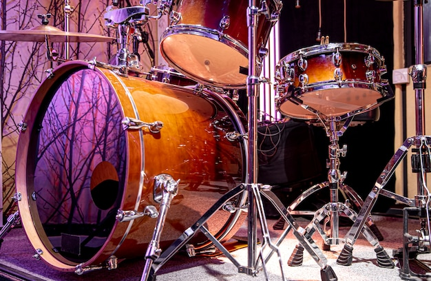 Drum kit, drums in the studio on a beautiful background close up.