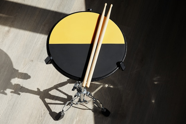 Drum practice pad and drumsticks. drummer.