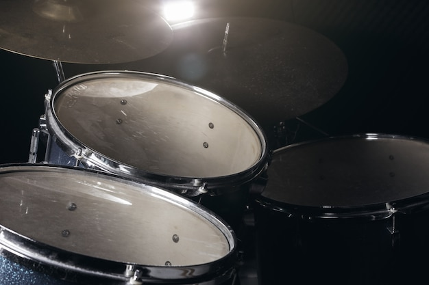 The drum set in low light background.