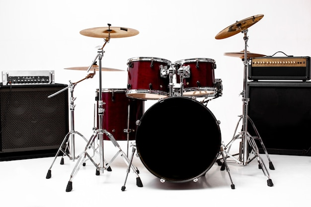 Drum set on white set of musical instruments