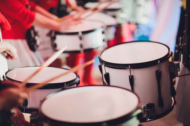Drummer plays with drumsticks on rock drum set