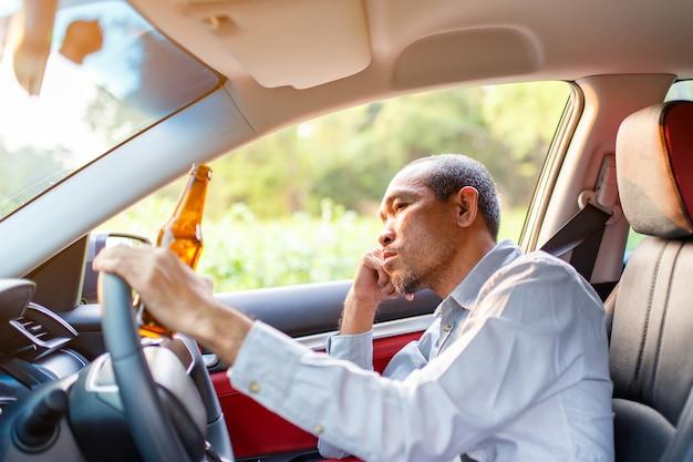 Drunk asian young man drives a car