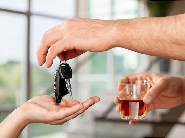 Drunk man giving car key to woman
