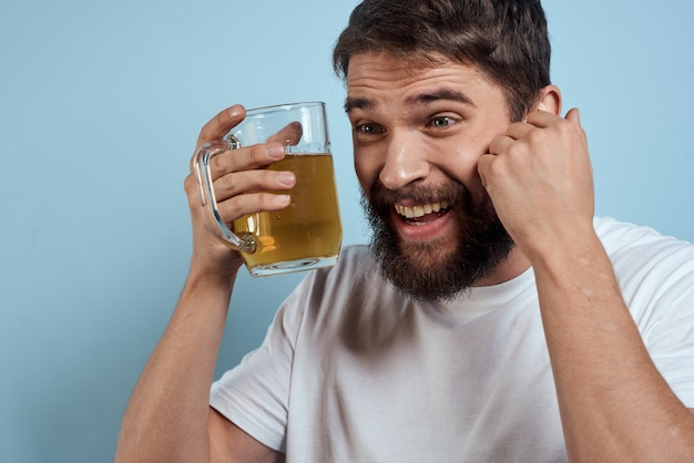 Drunk man posing with a beer