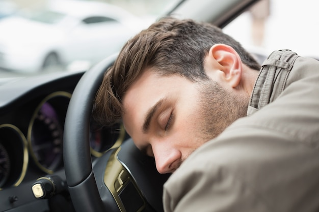 Drunk man slumped on steering wheel