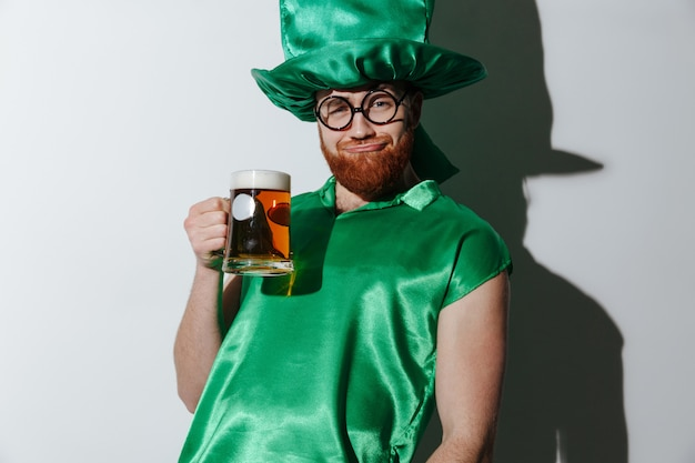 Drunk man in st.patriks costume holding beer
