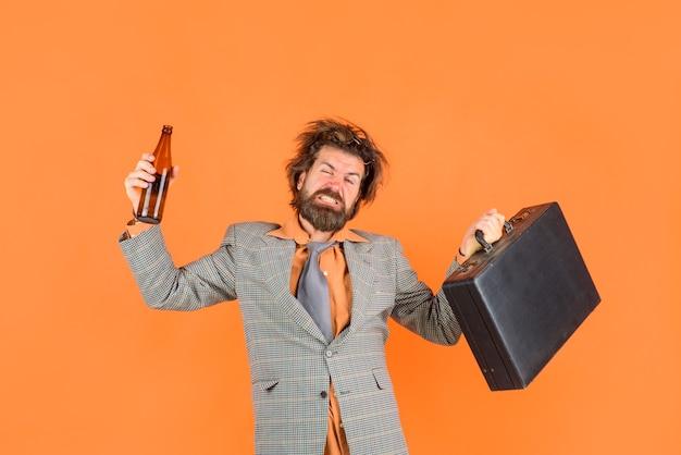 Drunk teacher with briefcase bearded man in suit education back to school portrait of male teacher