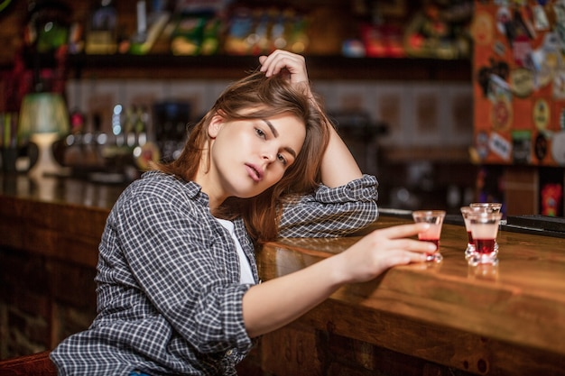 Drunk woman holding a glass of whisky or rum. woman in depression