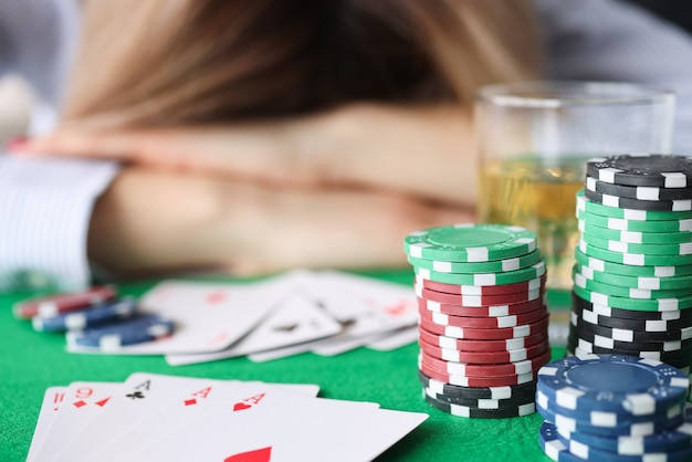 Drunk woman sleeping on gaming table in casino closeup. gambling addiction concept
