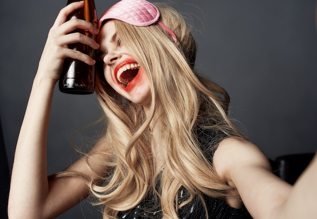 Drunk woman with a bottle of beer