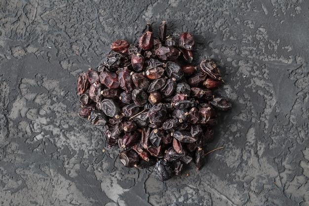 Dry berberis berries spice on dark stone