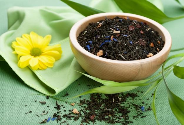 Dry black tea in bowl