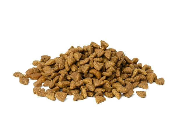 Dry cat food in the form of triangles isolated on white background, large pile