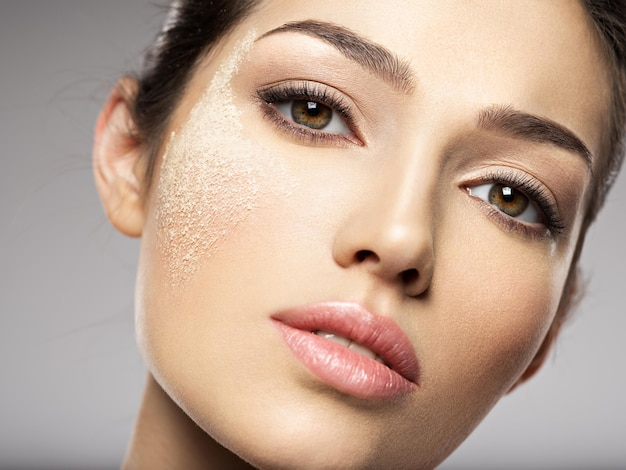 Dry cosmetic makeup powder is on the female face.  beauty treatment concept. girl makes makeup.