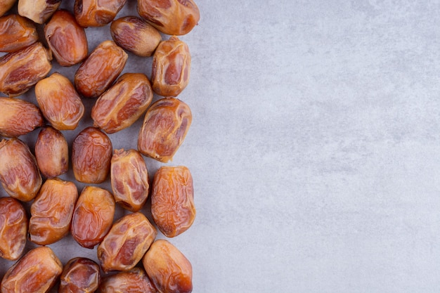 Dry dates isolated on concrete background. high quality photo