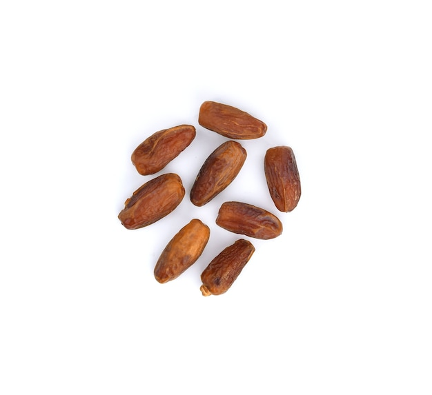 Dry dates isolated on white space. top view. flat lay pattern