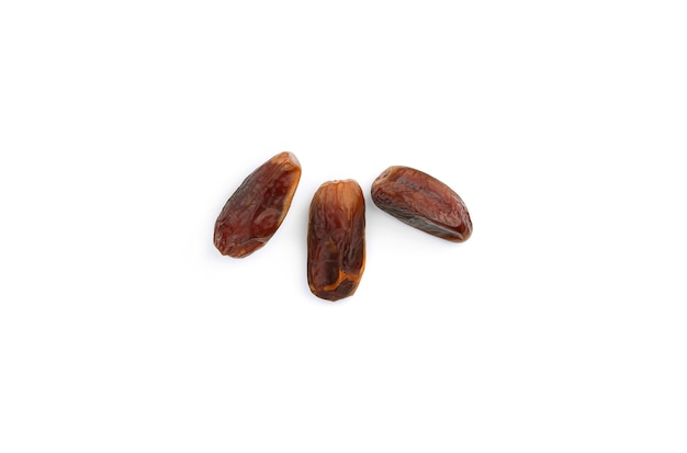 Dry dates isolated on white surface. top view. flat lay pattern