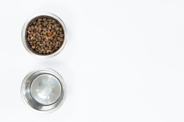 Dry dog food in metal bowl, top view and flat lay