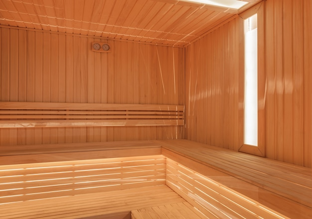 Dry finnish sauna with light wood and window
