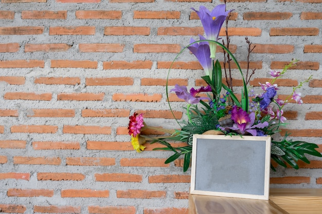 Dry flower on brick wall background texture
