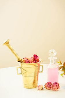 Dry flowers, mortar and vial of potion, herbal medicine