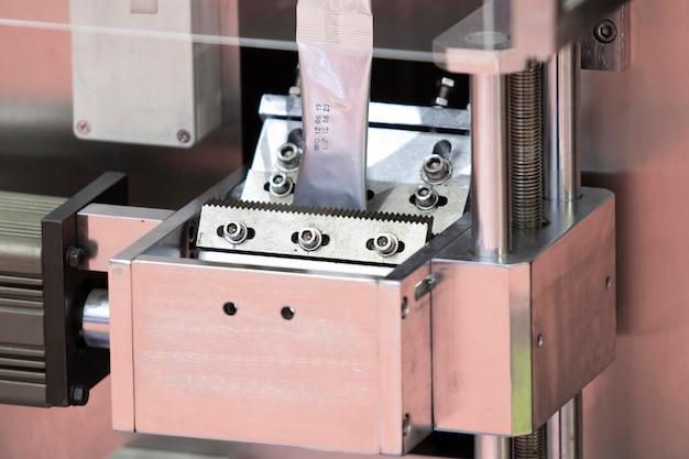 Dry food automatic packing machine using aluminium sheet ;industrial equipment background