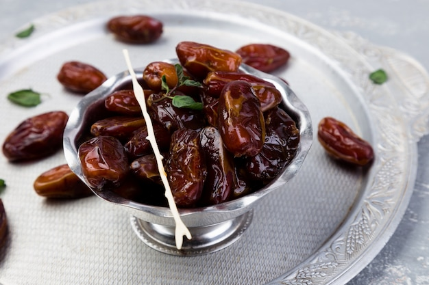 Dry fruit dates on silver tray,