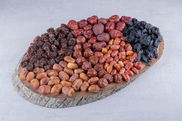 Dry fruits combination on a wooden platter. high quality photo
