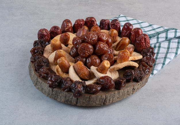 Dry fruits platter isolated on concrete surface.