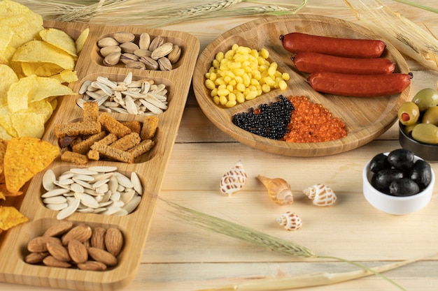 Dry fruits with snacks, sausages and olives