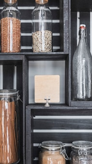 Dry grains in containers on a shelf mobile phone wallpaper