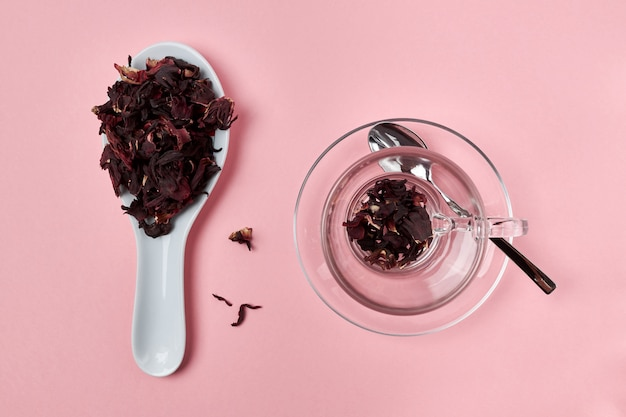 Dry hibiscus tea lies in a spoon