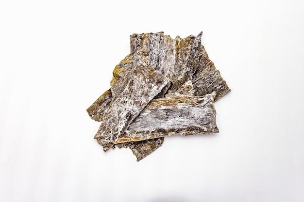 Dry laminaria japonica kelp isolated. kombu seaweed, traditional japanese ingredient for cooking dashi soup.