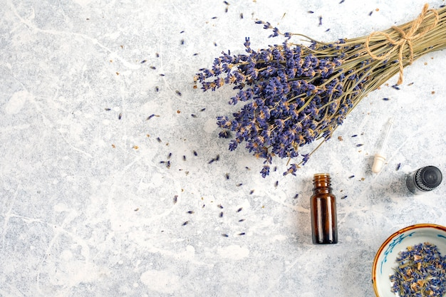 Dry lavender bunch with essentials oils isolated on white background