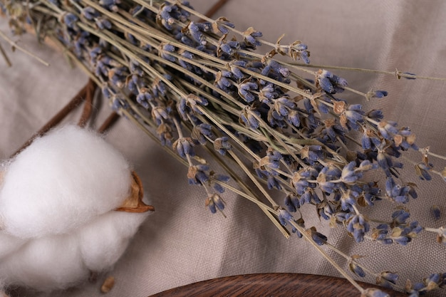 Dry lavender bunch on wooden background on a linen organic towel wooden table with lavender