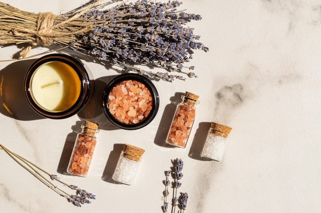 Dry lavender flowers and lavender aromatic sea salt with candle - natural skin care spa
