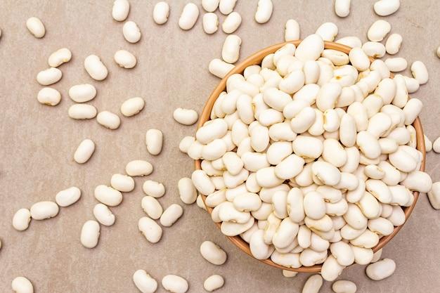 Dry lima beans in ceramic bowl