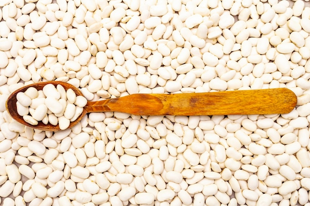 Dry lima beans with wooden spoon